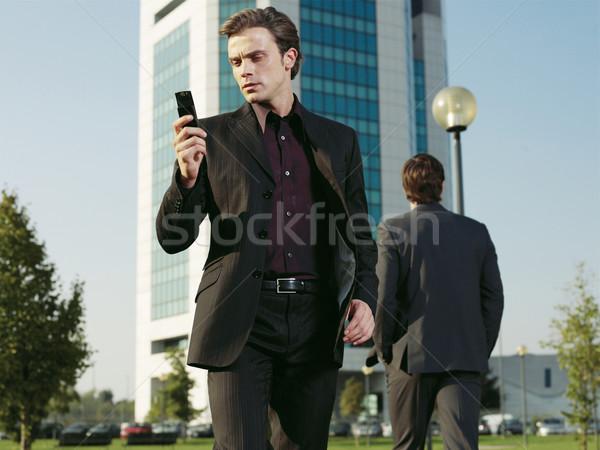 Businessman working near office aa Stock photo © toocan