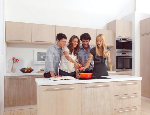 Gruppo giovani amici colazione moderno cucina Foto d'archivio © toocan
