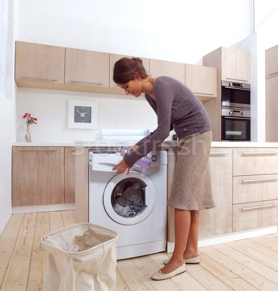 girl in the laundry room a Stock photo © toocan