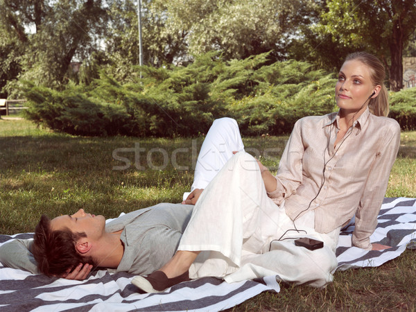 couple in love resting in the park Stock photo © toocan