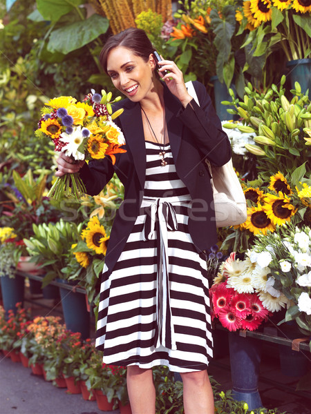 businesswoman with cell phone and flowers Stock photo © toocan