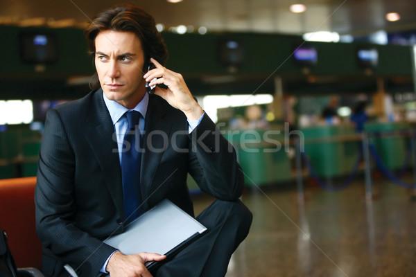 Imprenditore aeroporto seduta business riunione felice Foto d'archivio © toocan