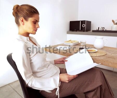 женщину глядя что-то есть дома Сток-фото © toocan