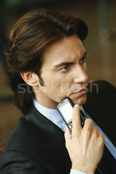 Handsome businessman talking on mobile phone Stock photo © toocan