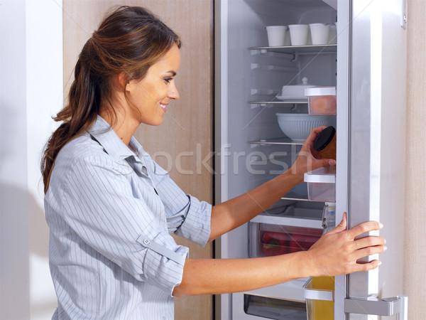 Nő hűtőszekrény fiatal nő lány szépség konyha Stock fotó © toocan