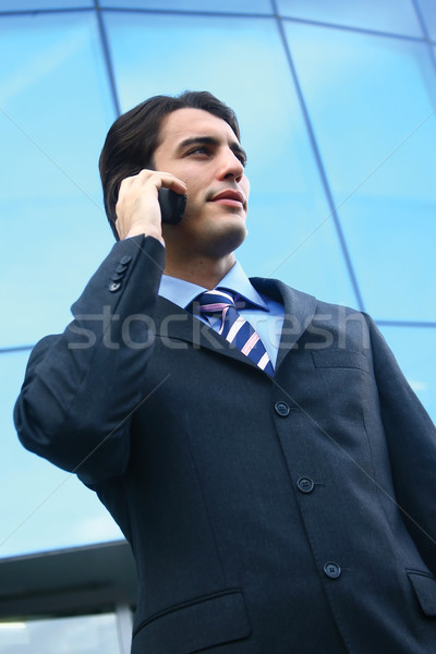 a businessman using mobile phone b Stock photo © toocan