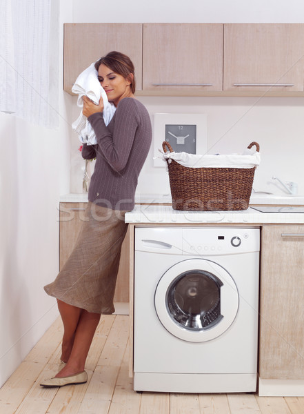 enjoys a smell of the washed things Stock photo © toocan