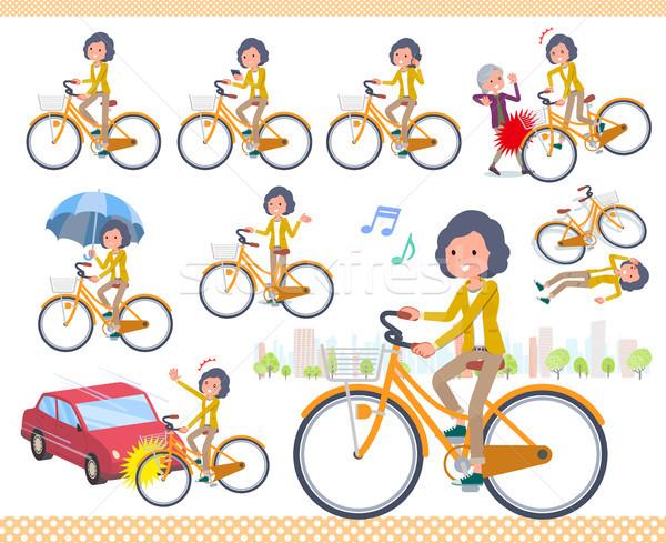 flat type Yellow jacket Middle women_city cycle Stock photo © toyotoyo