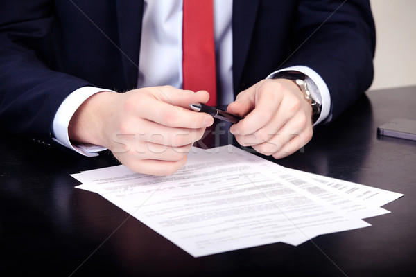Close-up of male hands with pen over document Stock photo © traza
