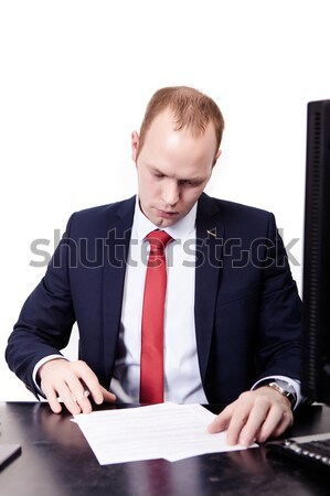 Serious American Businessman in red tie at the table working on  Stock photo © traza