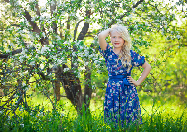 Adorable kid playing in nature. Cute little child, blonde toddler girl playing in blooming cherry ga Stock photo © traza