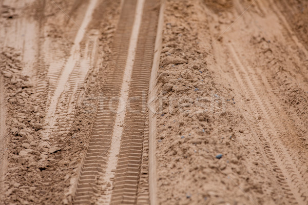 Tire tracks on the ground. Off road 4X4 wheel tracks on country desert beach road sand motoring back Stock photo © traza