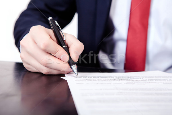 Businessman viewing the contract before signing. Stock photo © traza