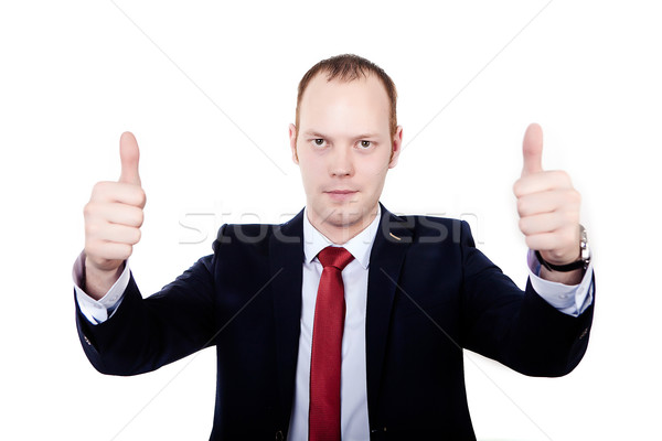 Purposeful businessman. hands clenched into fists and thumbs up. Stock photo © traza