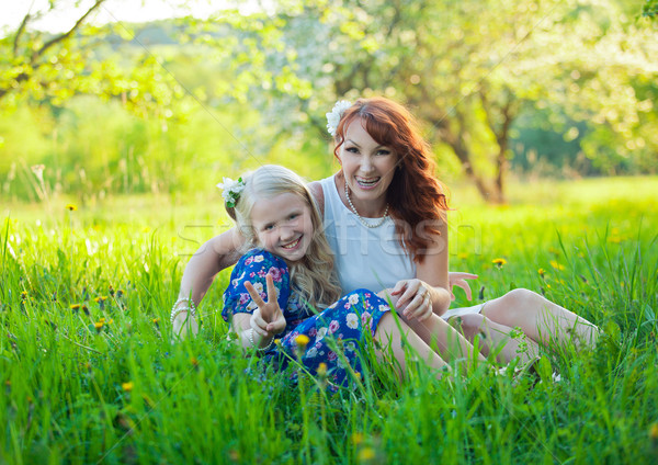 Little Girl and Mom Picking Apples. Portrait of happy mother and young daughter with heart. Stock photo © traza