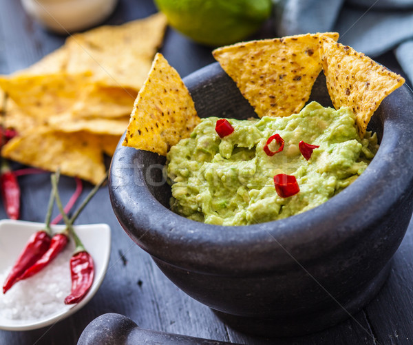 мексиканская кухня черный каменные чаши свежие Начо Сток-фото © trexec