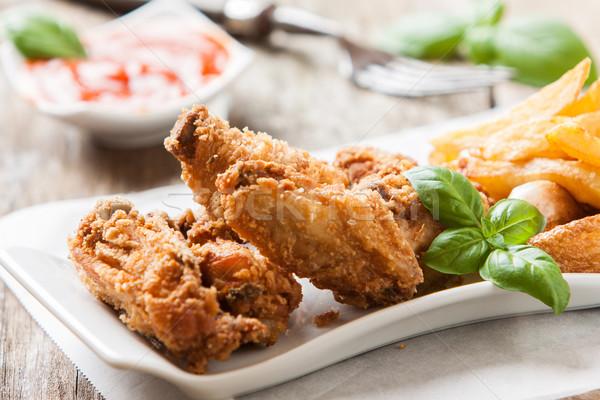 куриные фри глубокий жареная курица картофель фри соус Сток-фото © trexec
