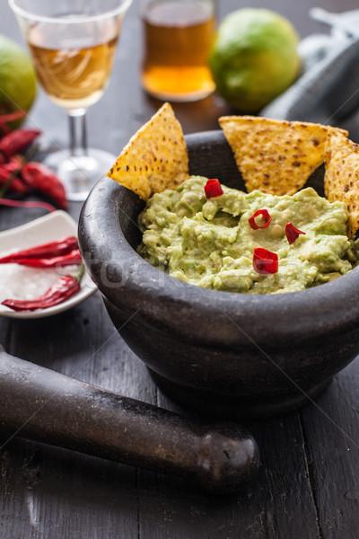 Mexikói étel fekete kő tál friss nachos Stock fotó © trexec