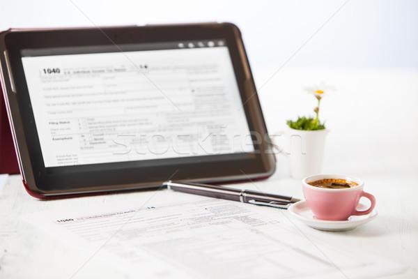 Vergi form 1040 fincan kahve tablet Stok fotoğraf © trexec