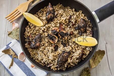 Italiano risotto frutos do mar preto nosso pote Foto stock © trexec