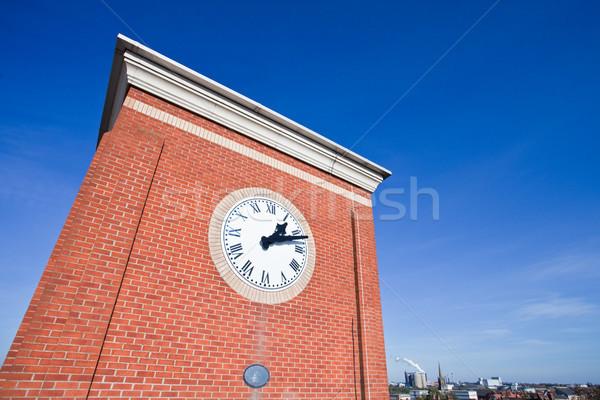 Saat kule modern canlı mavi gökyüzü Bina Stok fotoğraf © trgowanlock