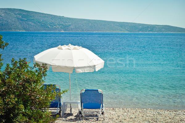 Strand parasol Griekenland zon paraplu vakantie Stockfoto © trgowanlock