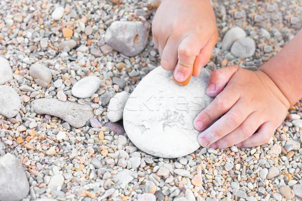 Gyermek rajz közelkép fiatal kezek kő Stock fotó © trgowanlock