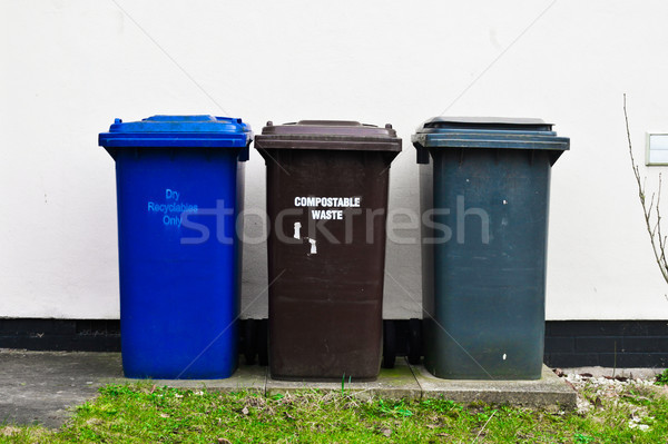 Drie plastic afval buiten huis muur Stockfoto © trgowanlock