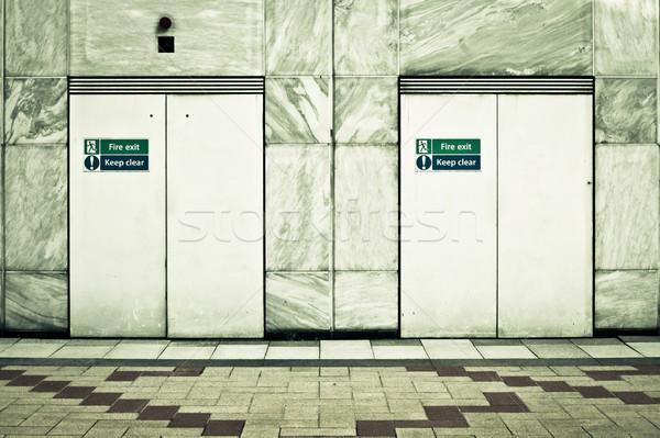 Tűz kettő kijárat ajtók modern városi Stock fotó © trgowanlock
