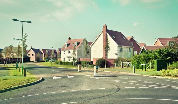Moderna casas casa nubes carretera edificio Foto stock © trgowanlock