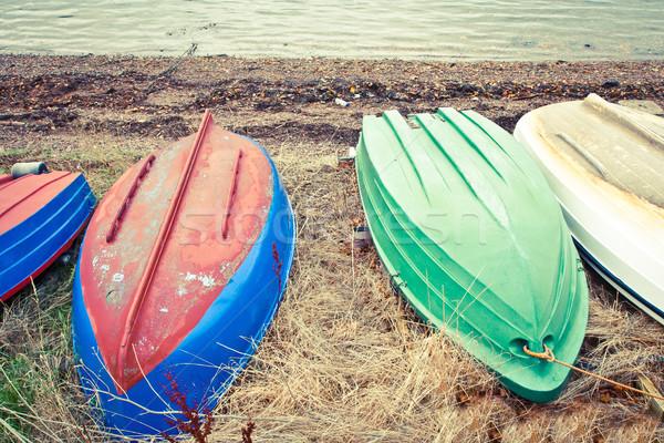 Roeien boten strand water hout Stockfoto © trgowanlock