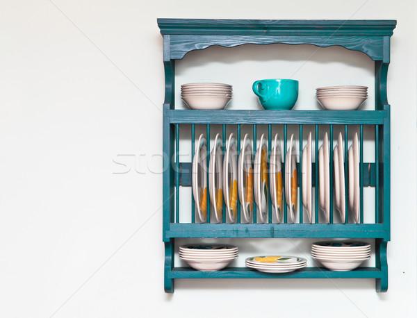 Prato cremalheira tigela casa de campo cozinha parede Foto stock © trgowanlock