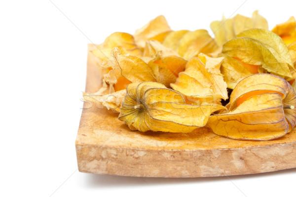 Gyümölcsök fából készült edény fehér étel természet Stock fotó © trgowanlock