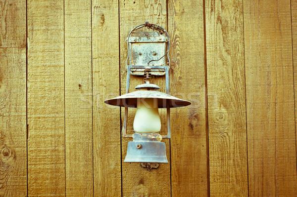 Vintage lamp mooie houten muur licht Stockfoto © trgowanlock