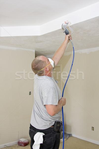 Painter spray painting Stock photo © Trigem4
