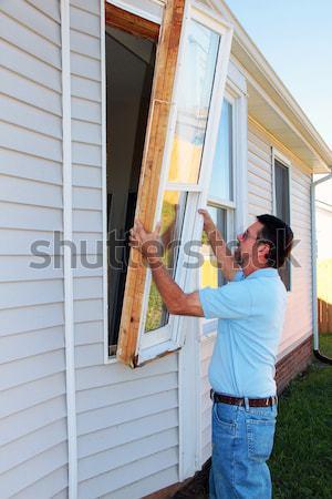 Painter painting trim around doors & windows Stock photo © Trigem4
