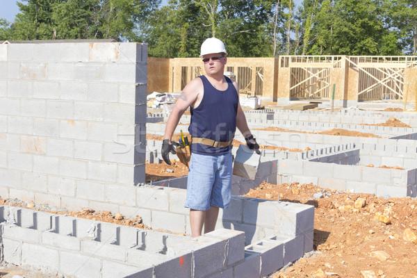 Mason with Concrete Block Stock photo © Trigem4