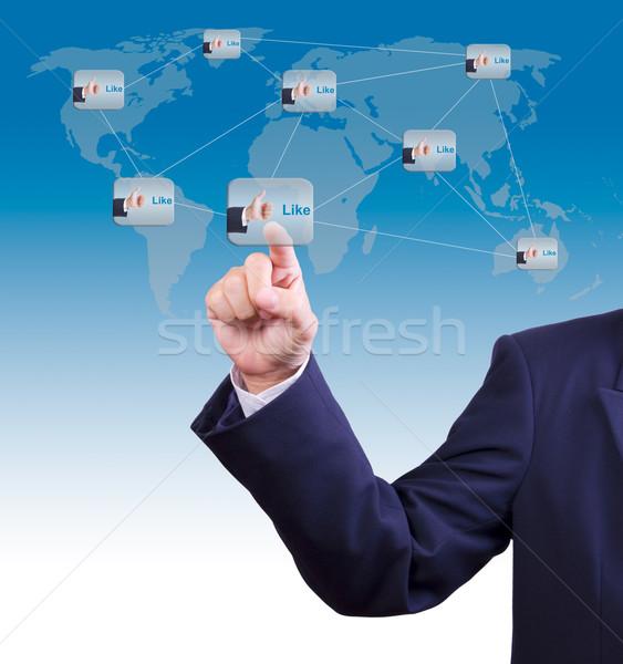hand pushing like button Stock photo © tungphoto