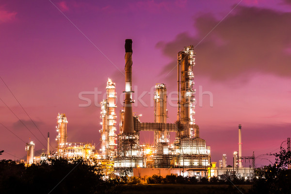Stock photo: oil refinery plant and smoke at twilight morning