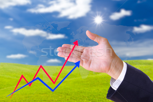 hand bring up the graph in blue sky Stock photo © tungphoto