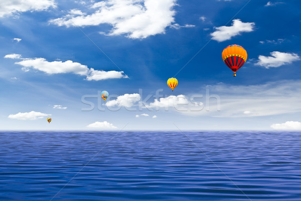 Stock photo: colorful hot air balloon on the sea
