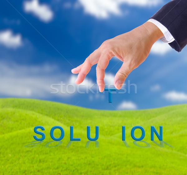 Zakenman hand oplossing woord groen gras weide Stockfoto © tungphoto