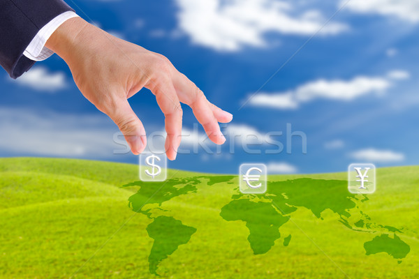 business man hand bring up dollar sign button Stock photo © tungphoto