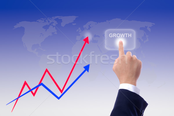 hand pushing growth button and graph Stock photo © tungphoto