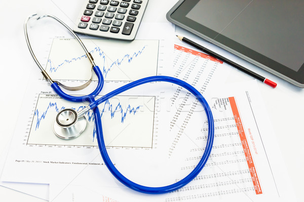 stethoscope with financial graph Stock photo © tungphoto