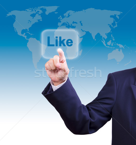 business man hand pushing like button Stock photo © tungphoto