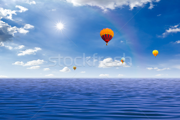 colorful hot air balloon on the sea Stock photo © tungphoto