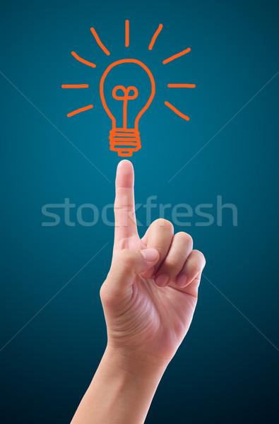 手 ポインティング 電球 光 ガラス 芸術 ストックフォト © tungphoto