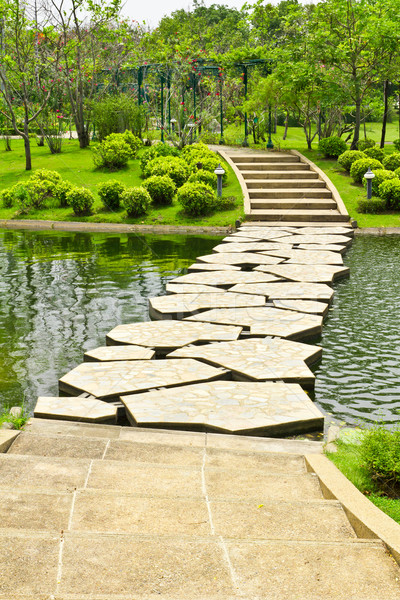 Stock photo: stone walkway on water in the park