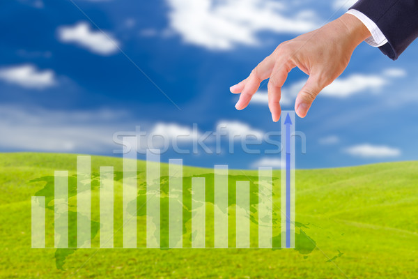 business man hand bring up the graph in blue sky Stock photo © tungphoto